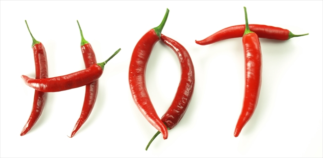 Hot word made with chili pepper on isolated background